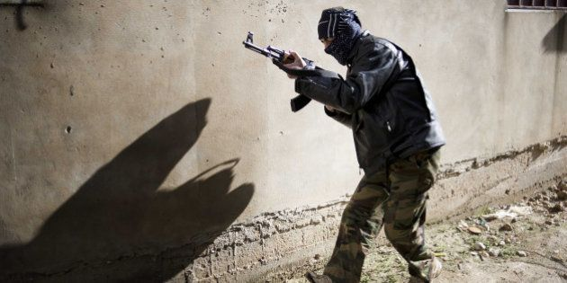 A member of the Free Syrian Army takes position in Al-Qsair, 25kms southwest of the flashpoint city Homs,...