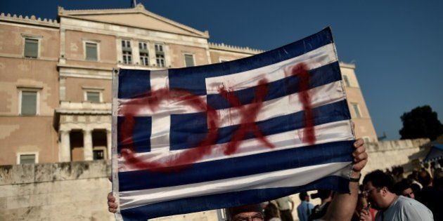 Protesters participate in a demonstration calling for a 'No' vote in the forthcoming referendum on bailout...