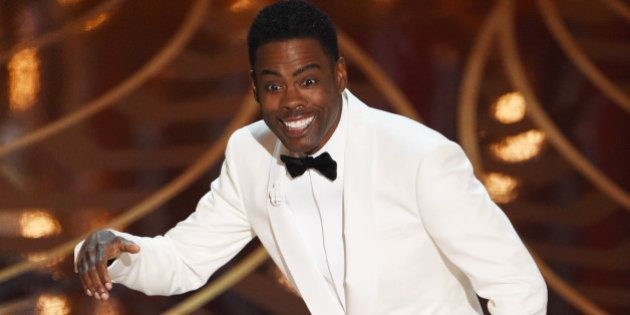 Actor Chris Rock presents on stage at the 88th Oscars on February 28, 2016 in Hollywood, California....