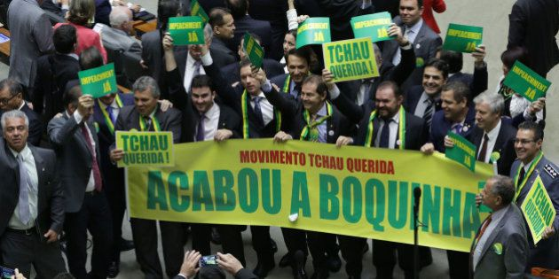 Opposition lawmakers hold a sign that reads in