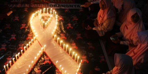 SURABAYA, INDONESIA - DECEMBER 01 : Indonesian students light dozens of candles as an act of solidarity...
