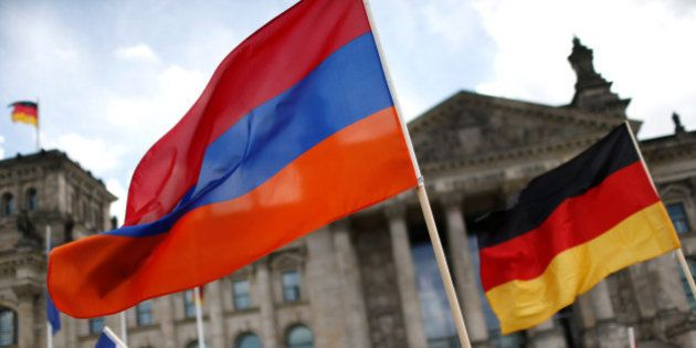 Supporters wave Armenian and German flags in front of the Reichstag, the seat of the lower house of parliament...