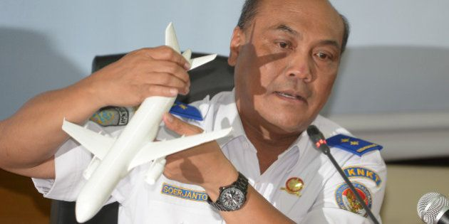 Indonesian Soejanto Tjahjono, head of the National Transportation Safety Committee (KNKT), holds a plane...