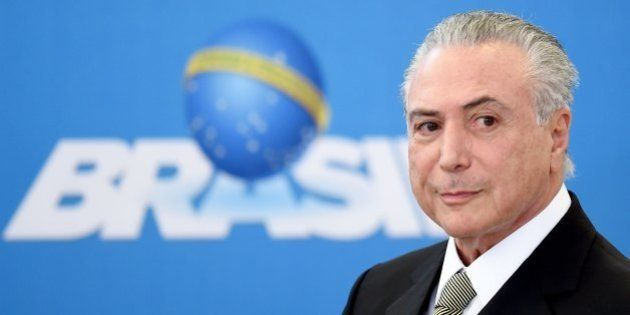 Brazilian acting President Michel Temer gestures during the inauguration ceremony of the presidents of...