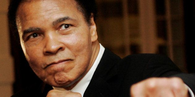 U.S. boxing great Muhammad Ali poses during the Crystal Award ceremony at the World Economic Forum (WEF)...