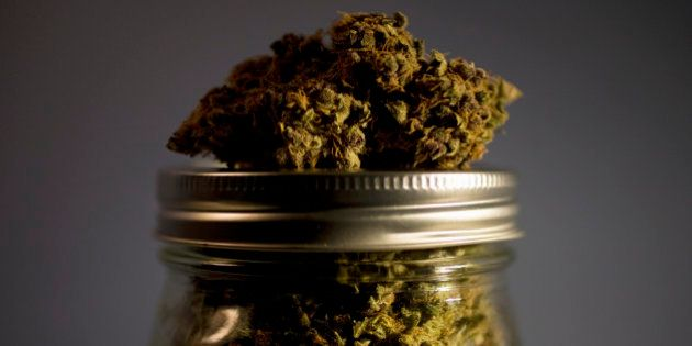 Marijuana strain on top of jar full of
