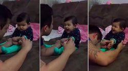 ASSISTA: Que fofo! Bebê dá sustos no pai enquanto ele corta suas