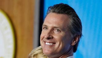 SACRAMENTO, CA - JANUARY 07: Governor Gavin Newsom carries his two year-old son Dutch while delivering his inaugural address after being sworn in as the 40th governor of California on January 7, 2019 in Sacramento, California. Gavin Newsom will begin his first term after serving as the 42nd Mayor of San Francisco as well as Lieutenant Governor of California since 2010 alongside outgoing governor Jerry Brown (Photo by Stephen Lam/Getty Images)