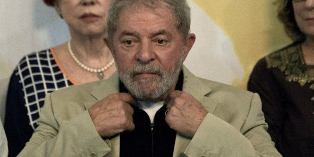 Brazilian former President Luiz Inácio Lula da Silva gestures during a meeting organized by the Central...