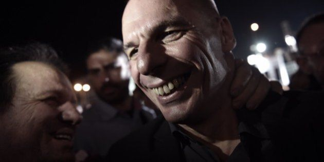 Greek Finance Minister Yanis Varoufakis is cheered by people during an address by the Greek prime minister...