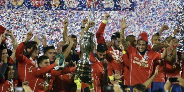 Chilean players celebrate with the trophy of the 2015 Copa America football championship, in Santiago,...