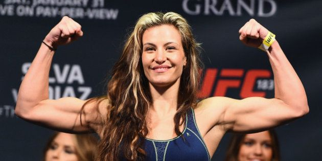 LAS VEGAS, NV - JANUARY 30: Miesha Tate steps on the scale during the UFC 183 weigh-in at the MGM Grand...