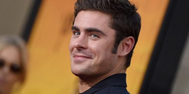 HOLLYWOOD, CA - AUGUST 20: Actor Zac Efron arrives at the premiere of Warner Bros. Pictures' 'We Are...