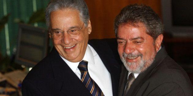 Brazilian President-elect Luiz Inacio Lula da Silva laughs with outgoing President Fernando Henrique...