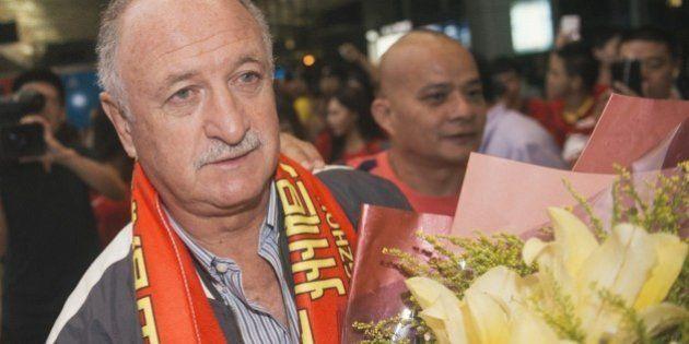 This picture taken on June 11, 2015 shows former Brazil coach Luiz Felipe Scolari (centre L) arriving...