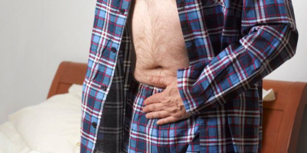 Mature man suffering with stomach