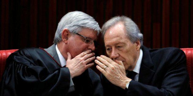 President of Brazil's Supreme Court Ricardo Lewandowski (R) speaks with Prosecutor-General Rodrigo Janot...