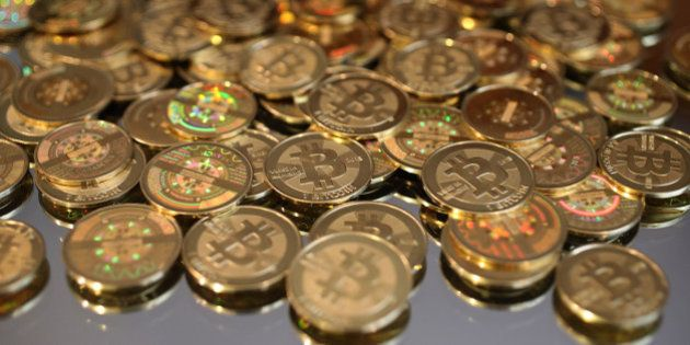 SALT LAKE CITY, UT - APRIL 26: A pile of Bitcoins are shown here after Software engineer Mike Caldwell...