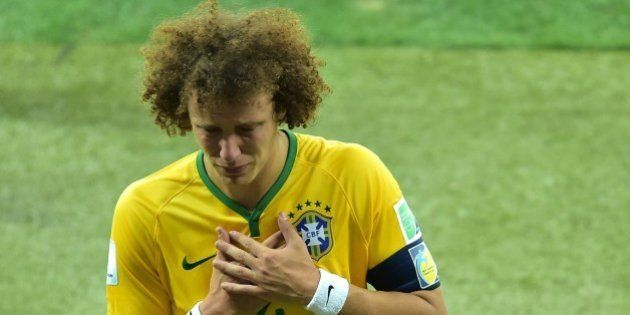 Brazil's defender David Luiz walks off the pitch after losing the semi-final football match between Brazil...