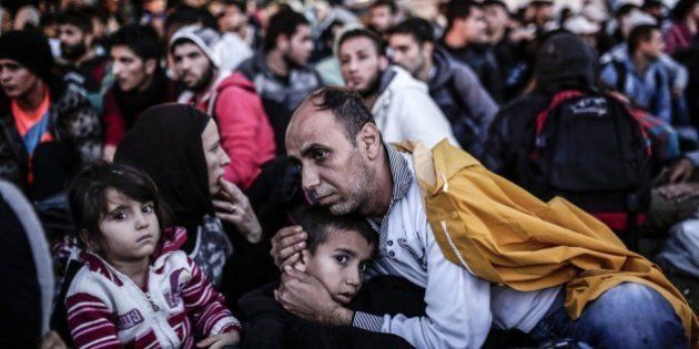 Migrants and refugees wait at Istanbul's Esenler Bus Terminal for buses to the Turkish-Greek border after...