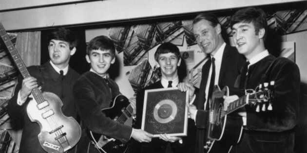 8th April 1963: British pop group The Beatles holding their silver disc. Left to right are, Paul McCartney,...