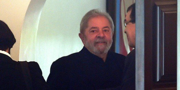 Former Brazilian president Luiz Inacio Lula da Silva arrives at the home of Senate President Renan Calheiros...