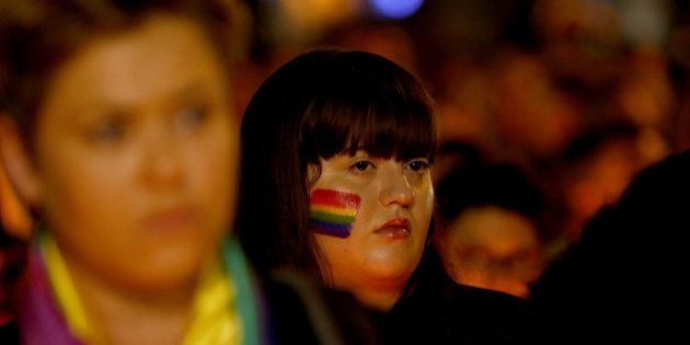 SYDNEY, AUSTRALIA - JUNE 13: A woman attends a candlelight vigil for the victims of the Pulse Nightclub...