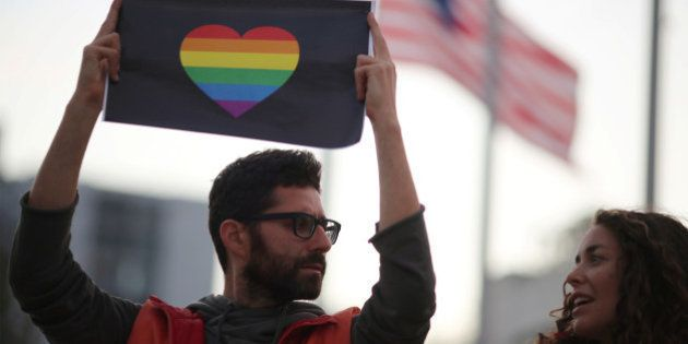 People attend a vigil in West Hollywood, California, following the early morning shooting at a gay nightclub...