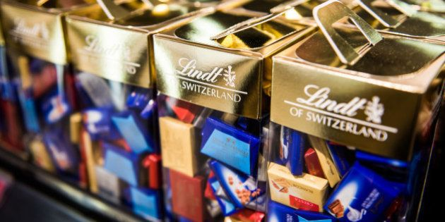Boxes of Lindt & Spruengli AG chocolates sit on display at a duty free store inside Zurich Airport, Switzerland...