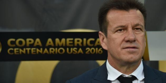 Brazil's coach Dunga waits for a Copa America Centenario football match against Haiti in Orlando, Florida,...