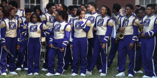 NEW ORLEANS, LA - AUGUST 28: Members of the Warren Easton High School marching band wait to greet former...