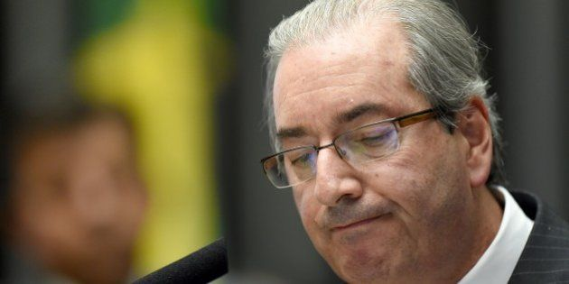 The president of the Brazilian Chamber of Deputies, Eduardo Cunha gestures during a session at the National...