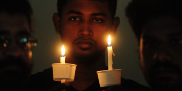 Indian members of LGBT (lesbian, gay, bisexual, and transgender) community observe a candlelight vigil...