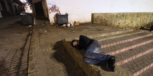 A Moroccan homeless youth sleeps in a street in the northeastern coastal city of Tangier, on January...