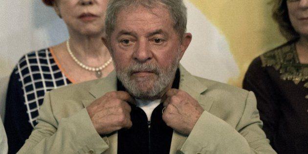 Brazilian former President Luiz Inácio Lula da Silva gestures during a meeting organized by the Central...