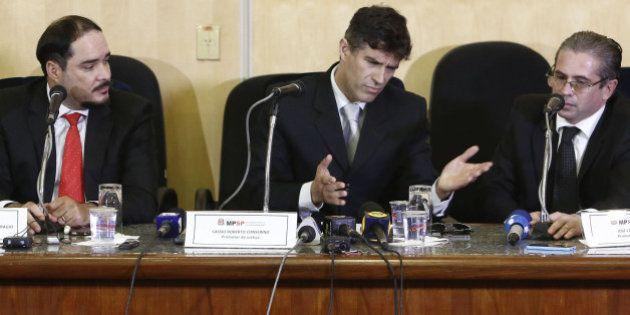Brazilian state prosecutors Fernando Henrique de Moraes Araujo (L), Cessio Roberto Conserino (C) and...