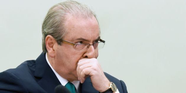Brazilian suspended president of the Lower House of Congress Eduardo Cunha gestures as he testifies before...