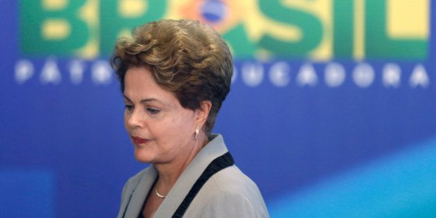 Brazil's President Dilma Rousseff leaves at the end of a government ceremony at the Planalto presidential...