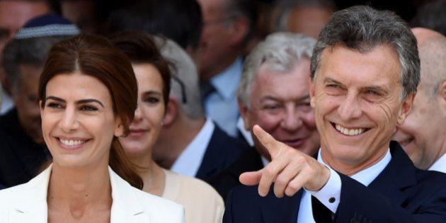 Argentina's President Mauricio Macri (R) and his wife, first lady Juliana Awada leave the Metropolitan...