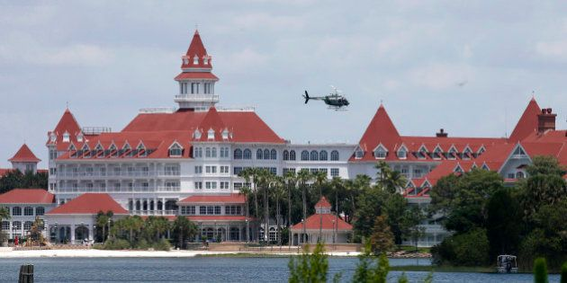 A Florida Fish and Wildlife Conservation Commission helicopter flies over the Seven Seas lagoon at Walt...