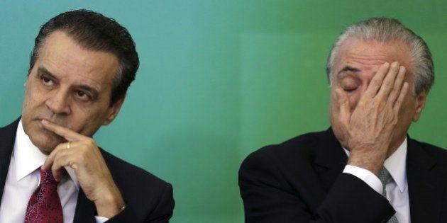 The new Minister of Tourism Henrique Eduardo Alves reacts near of Brazil's Vice President Michel Temer...