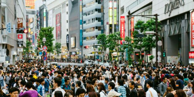 People crossing the road in famous Shibuya crossroad, Minato Ward, Tokyo,