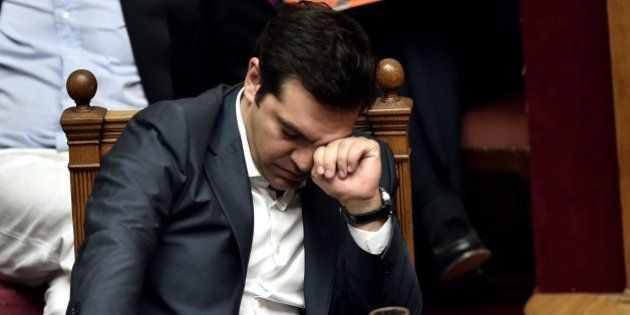 Greek Prime Minister Alexis Tsipras reacts during a parliament session in Athens on July 15, 2015. AFP...
