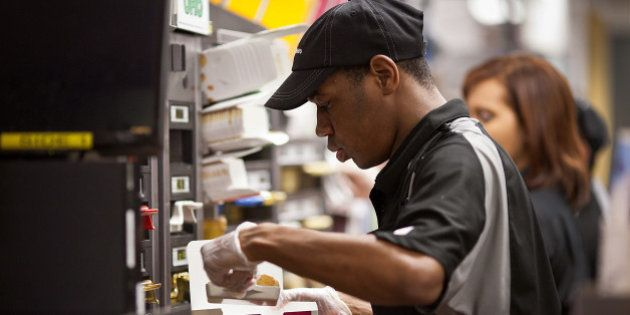 A worker puts together an order of Chicken McNuggets at a McDonald's Corp. restaurant in Little Falls,...