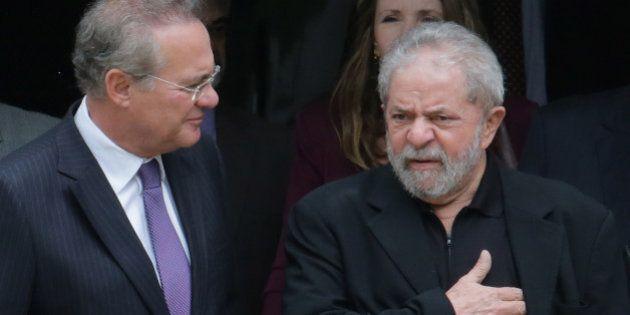 Brazil's former President Luiz Inacio Lula da Silva, right, and Senate President Renan Calheiros, chat...