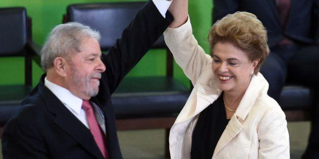 Former Brazilian president Luiz Inacio Lula da Silva (L) and Brazilian president Dilma Rousseff gesture...
