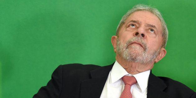Former Brazilian president Luiz Inacio Lula da Silva gestures next to Brazilian president Dilma Rousseff...