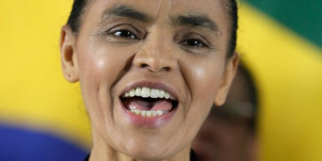 Marina Silva, left, a former senator and environment minister, sings her country's national anthem, during...