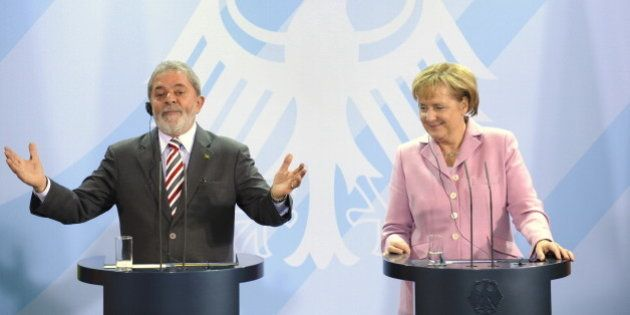Brazilian President Luiz Inácio Lula da Silva and German Chancellor Angela Merkel address a press conference...