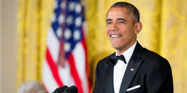 President Barack Obama pauses while speaking at the 2015 Kennedy Center Honors reception in the East...